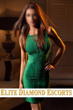 Raissa poses for the camera and shows off her curves in a tight green dress