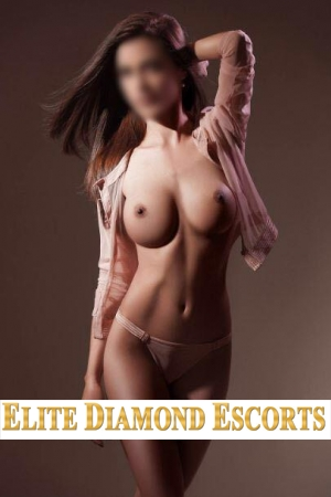 Nottingham escort Raissa poses in only a pink jacket and thong. She shows off her perky breasts